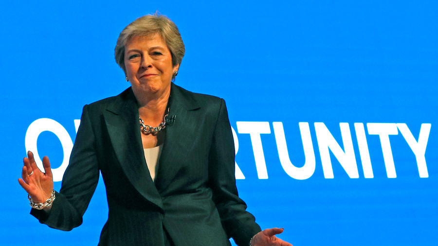 A look back at Theresa May's awkward dancing career that's bringing the 'robot' back