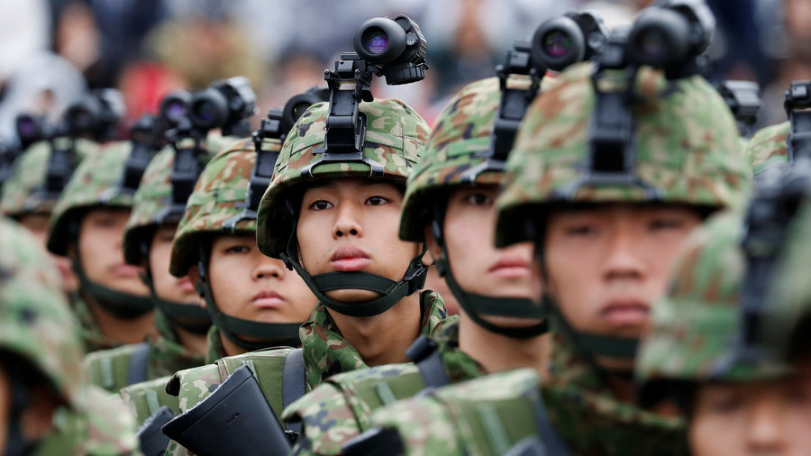 'You've gained public trust': Japan's Abe boasts army's reputation as he drives to beef up defense