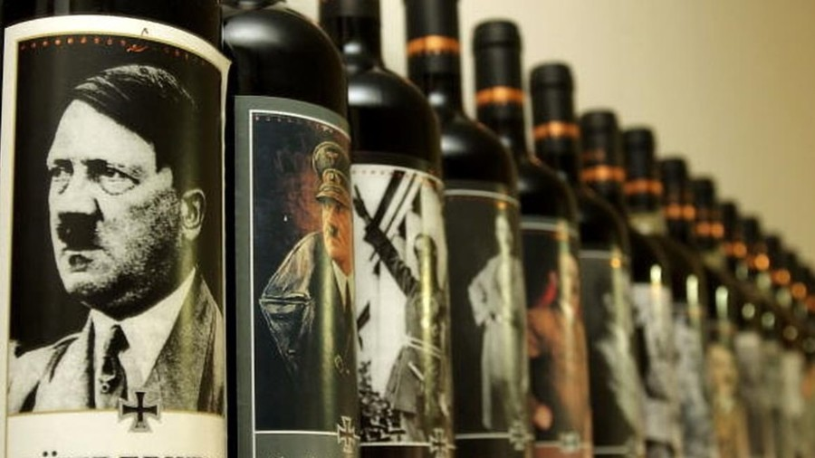 Fuhrer-wine: German MP caught posing with wine bottles featuring photos of Hitler