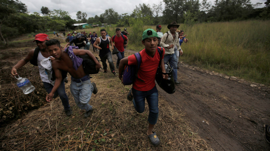 Migrant Caravan Clash With Mexican Police, Break Down Border Fence