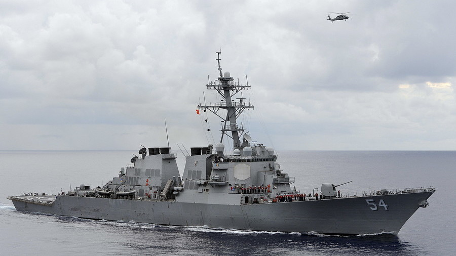 United States  warships sail in disputed waters