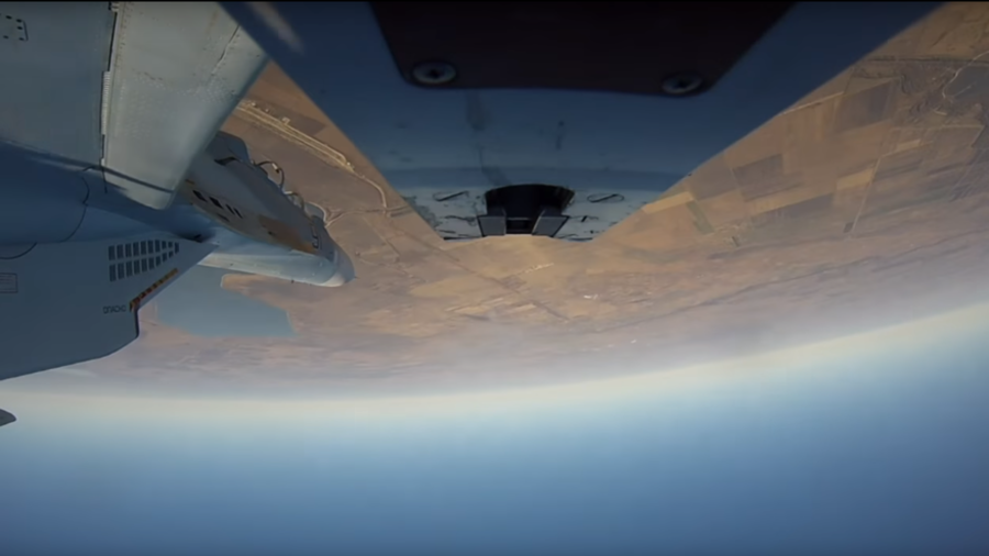 Russian fighter jets fly upside-down, fire missiles in spectacular stratospheric drills (VIDEO)