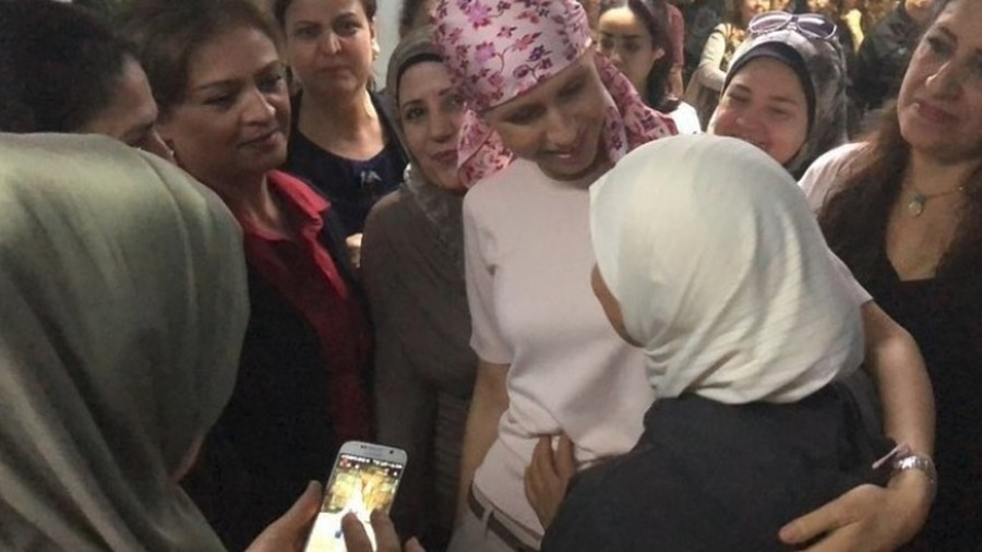 Syria's cancer-stricken First Lady Asma Assad filmed warmly speaking to hospital patients (VIDEO)