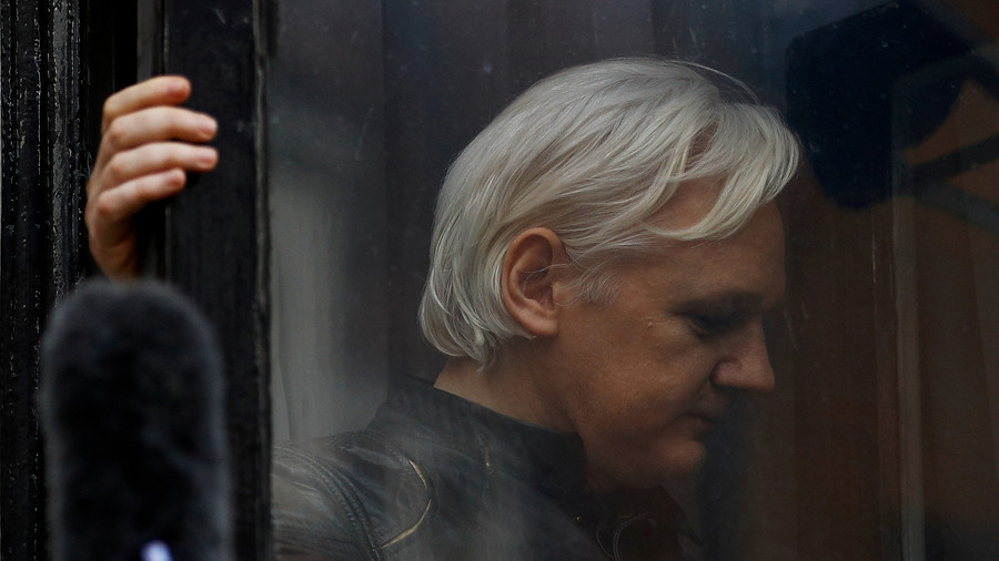 Assange says Ecuador wants to hand him over to US