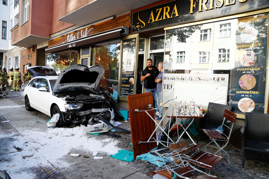 Car drives into group of people in Berlin cafe, at least 5 injured