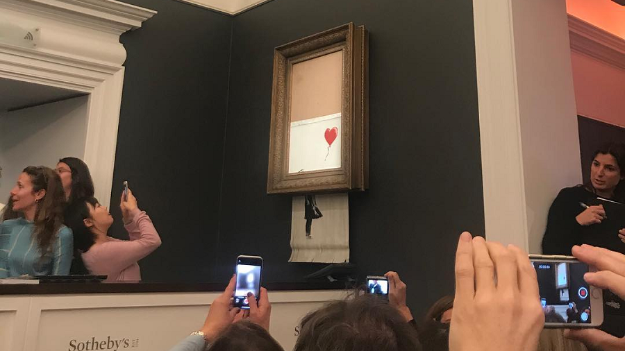 'We've been Banksy'd!' Balloon girl self-destructs on fetching $1.3mn at Sotheby's auction (VIDEOS)