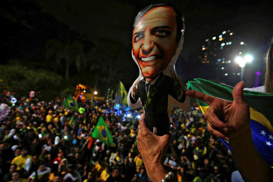 Right-wing Bolsonaro wins Brazilian election in landslide despite mass protests