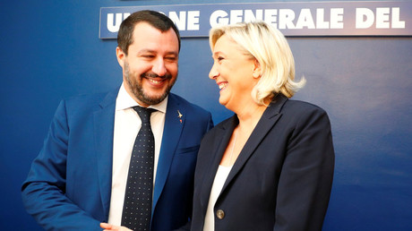 French National Rally leader, Marine Le Pen, and Italy's Lega leader and Interior Minister Matteo Salvini shake hands before holding a news conference in Rome, Italy, on October 8, 2018. © REUTERS/Max Rossi