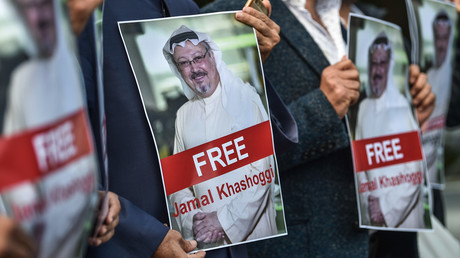 FILE PHOTO Protesters hold pictures of missing journalist Jamal Khashoggi in front of the Saudi Arabian consulate in Istanbul © AFP / Ozan Kose
