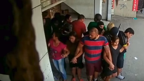 WATCH moment armed robbers break into lottery shop in Brazil, use 25 hostages as human shields