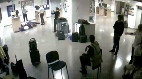 Ryanair release CCTV to expose 'fake photo' of crew sleeping on airport floor (VIDEO)
