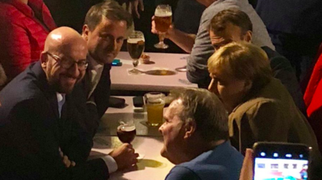 Driven to drink? Merkel, Macron and other EU leaders enjoy beers and fries after Brexit talks