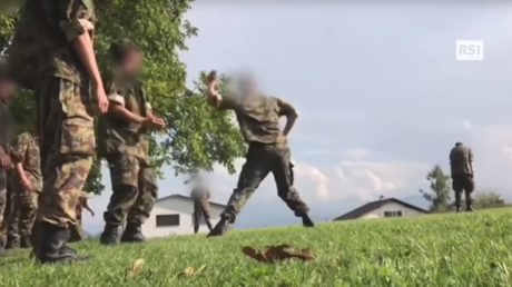 VIDEO of Swiss soldiers caught 'stoning' young recruit goes viral