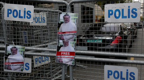 Pictures of Saudi journalist Khashoggi placed on security barriers during a protest outside the Saudi Consulate in Istanbul © Reuters / Murad Sezer