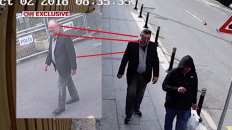 Journalist Jamal Khashoggi (L) pictured outside the embassy before his disappearance. A man identified as Mustafa al-Madani (R), wearing Khashoggi's clothes hours later © CNN