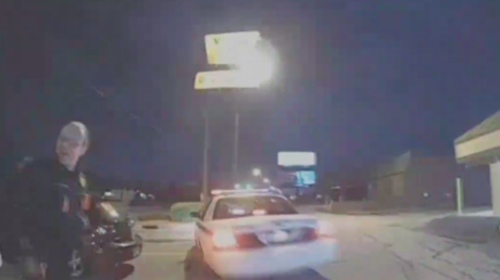 Handcuffed woman steals police car right in front of officers (BODY CAM VIDEO)