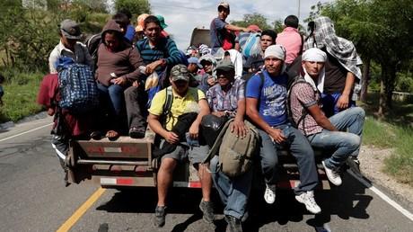 Trump cracks down on asylum claims as caravans surge north