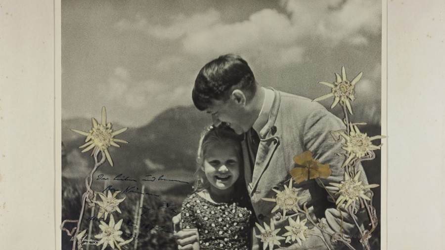 'Fuehrer's child': Stunning photo of Hitler hugging Jewish girl goes on sale in US (VIDEO)
