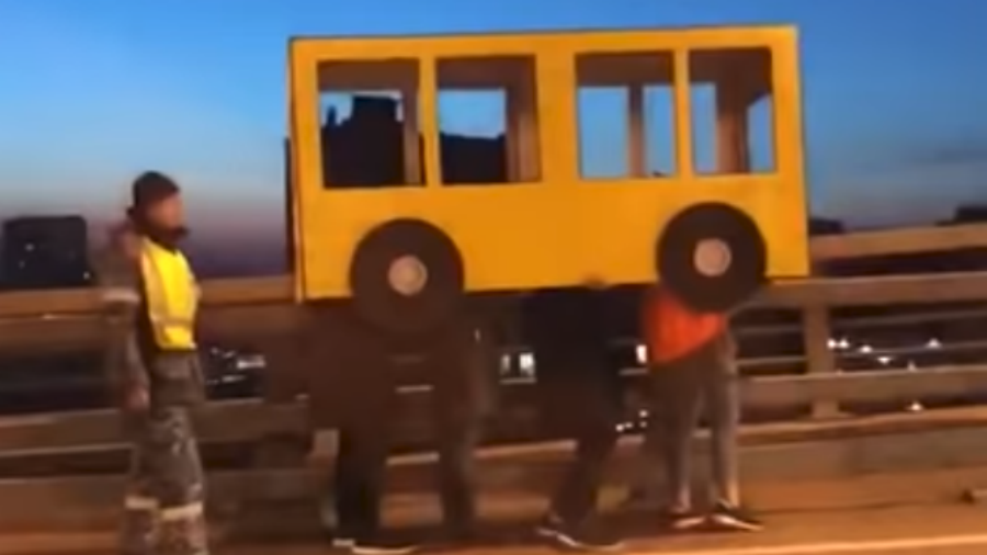 Russians dress up as 'bus' to cross bridge... and get BUSted (VIDEO)