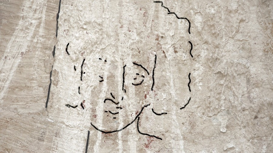 Curly headed & clean shaven: Long lost depiction of Jesus offers totally different portrayal