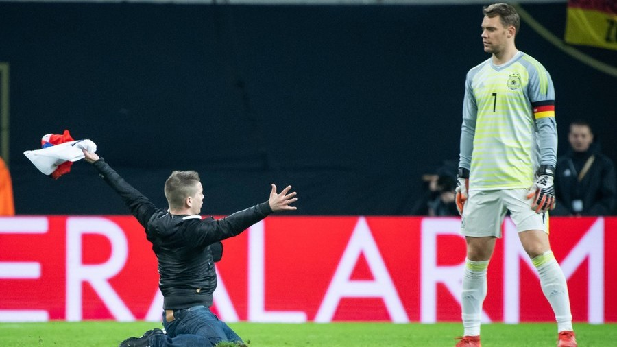 'I hope he wasn't proposing': Bizarre pitch invader knee-slides to Neuer in Russia v Germany game