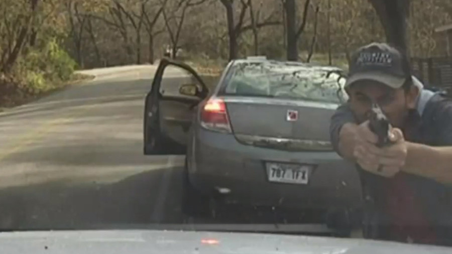 Gunman lays waste to police cruiser as officer miraculously survives shootout (VIDEO)