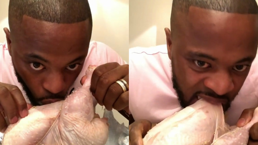 Finger lickin' good?: Former Manchester United defender Evra fondles raw turkey in bizarre video