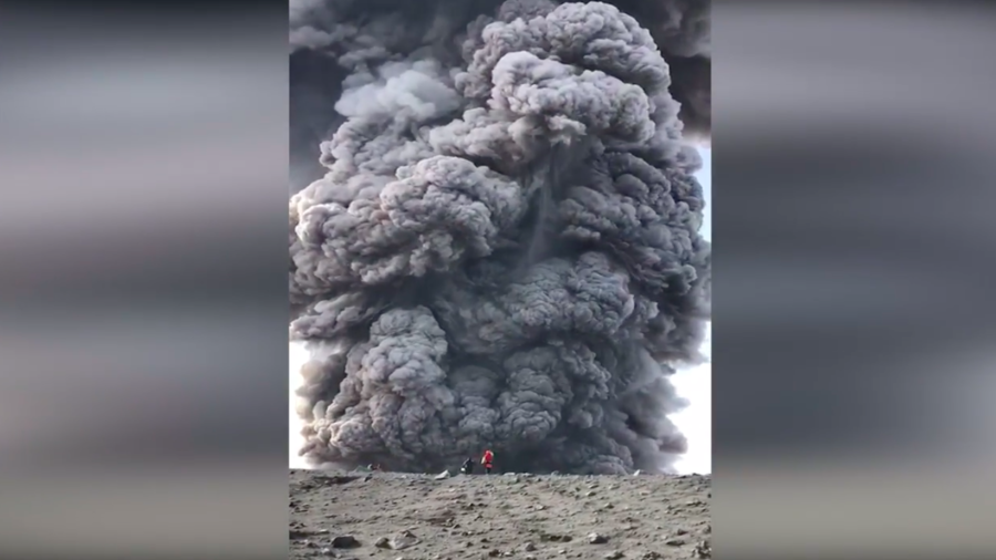 Brave or stupid? Russian hikers walk up volcano… as it erupts (VIDEO)