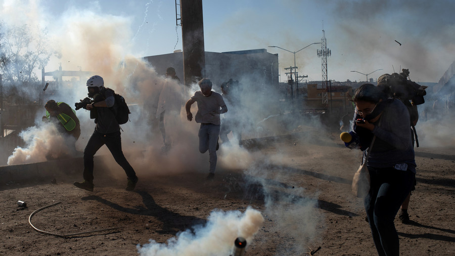 US border patrol repels migrants with tear gas after Mexico crossing closure