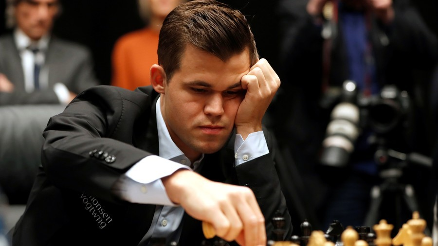 Carlsen beats Caruana in tiebreakers to defend World Chess Championship title