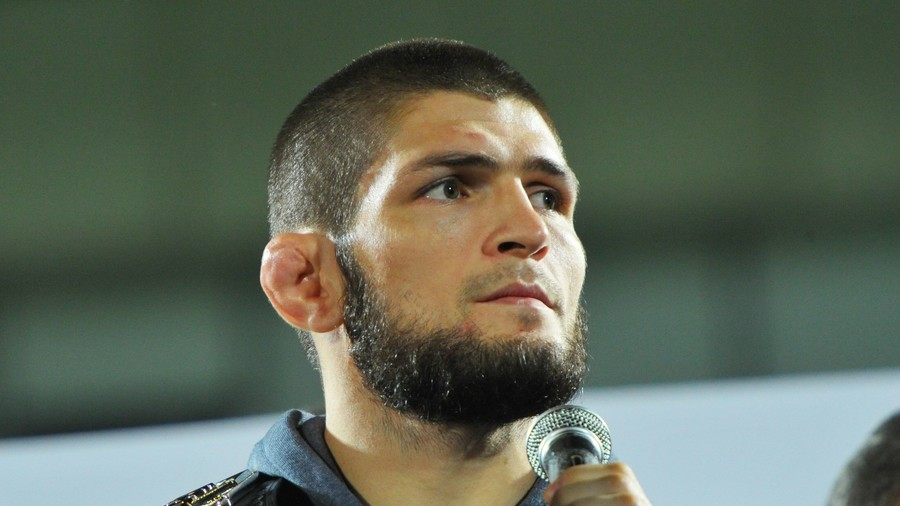 'Put him in midfield!' Football-mad Khabib watches PSG v Liverpool UCL clash (PHOTOS)