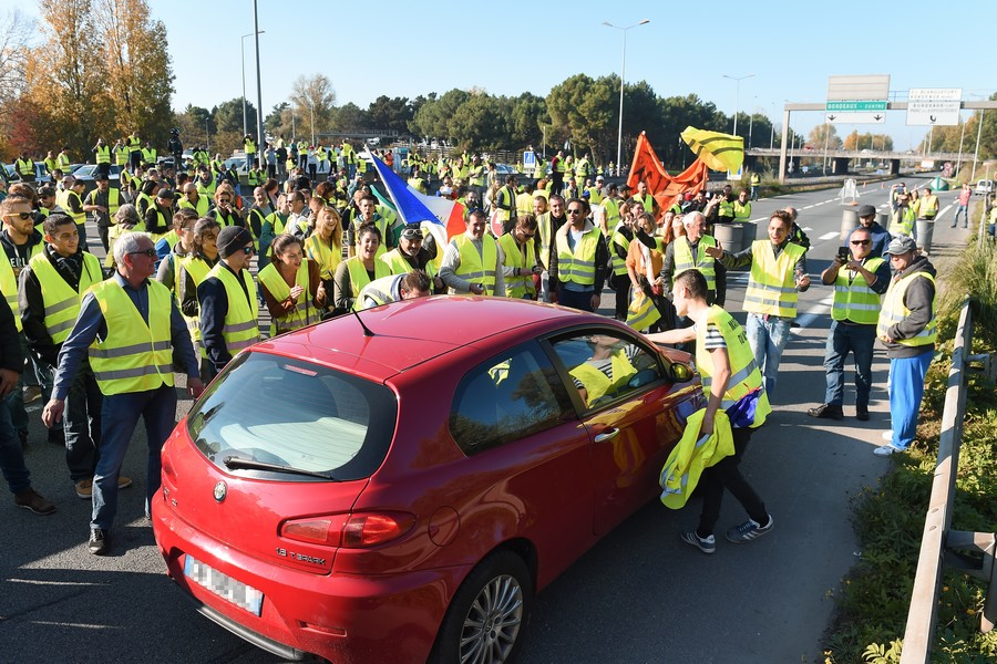 Woman dies in France after driver 'frightened' by fuel price protesters ploughs through crowd