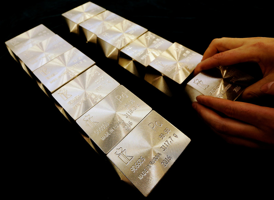 Bitcoin investors switching from virtual coins to paper gold, investment strategists say
