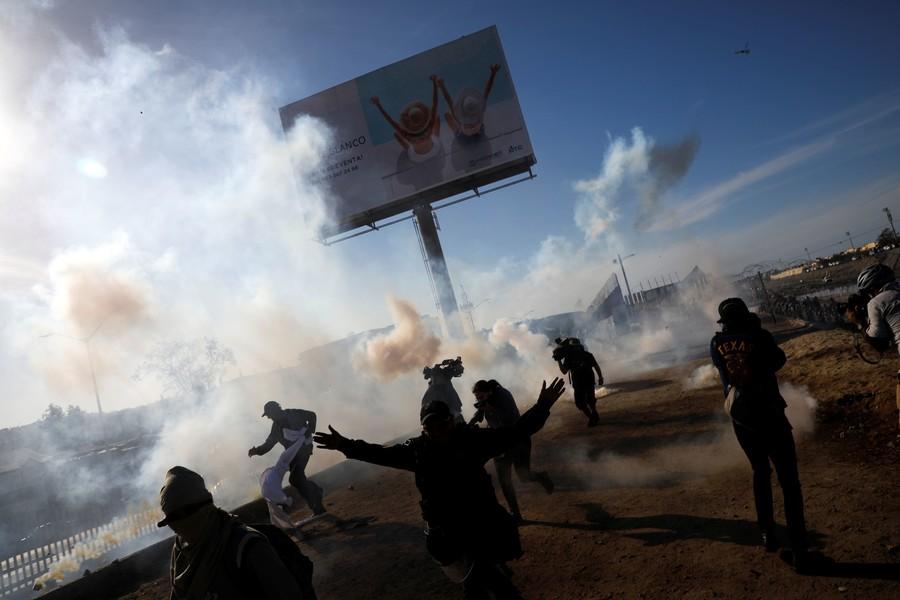 Police use tear gas on migrants at U.S. border