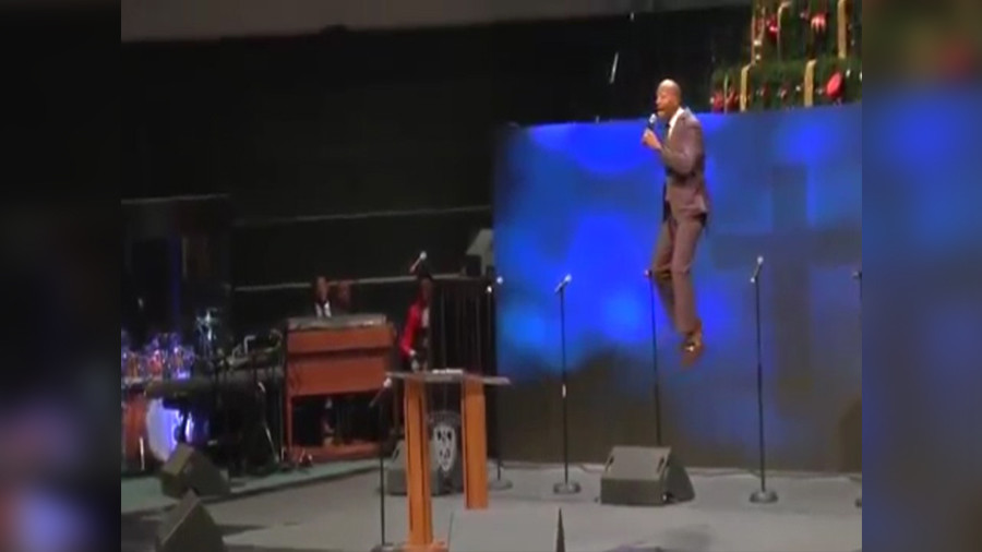 'Flying pastor' swings off church ceiling to portray Jesus' return (VIDEO)