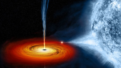 Massive black hole's spectacular spin 'may rotate space around it'