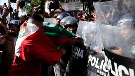 'Mexico First'? Riot police face off with protesters against US-bound 'invaders' in Tijuana (VIDEOS)