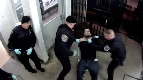 CCTV footage show Elkhart PD officers beating a handcuffed suspect © YouTube / ProPublica