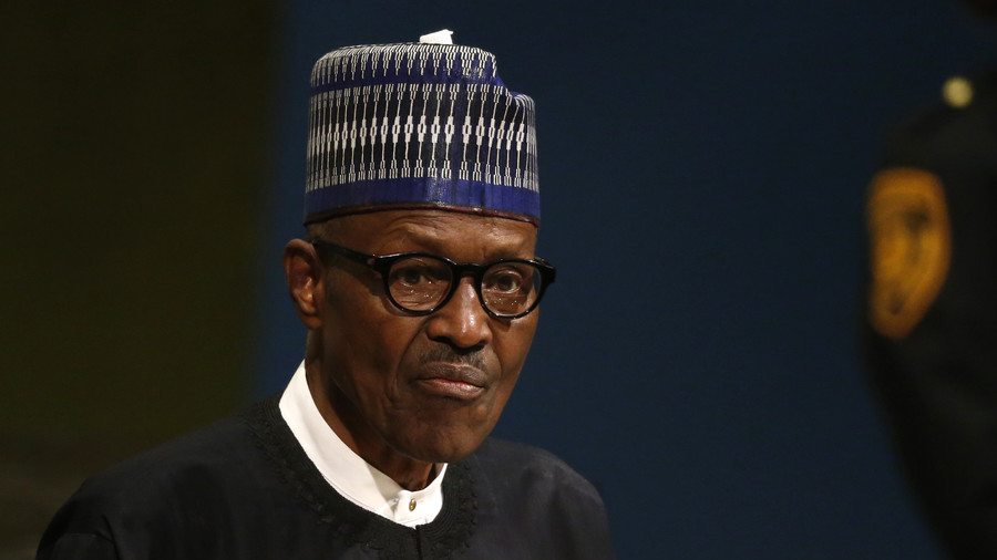 In Poland, President Buhari dismisses