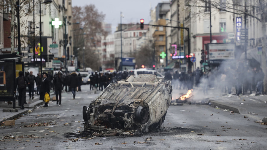 French students block high schools, burn cars and throw stones at police amid massive protests