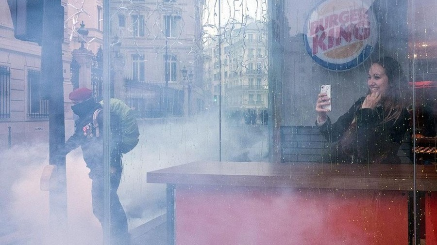 Selfie while Paris burns? Woman's Burger King snap 'captures spirit of the era'