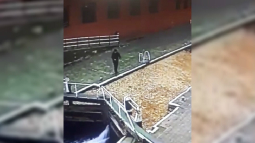 Heads up! CCTV captures distracted man walking straight into canal (VIDEO)