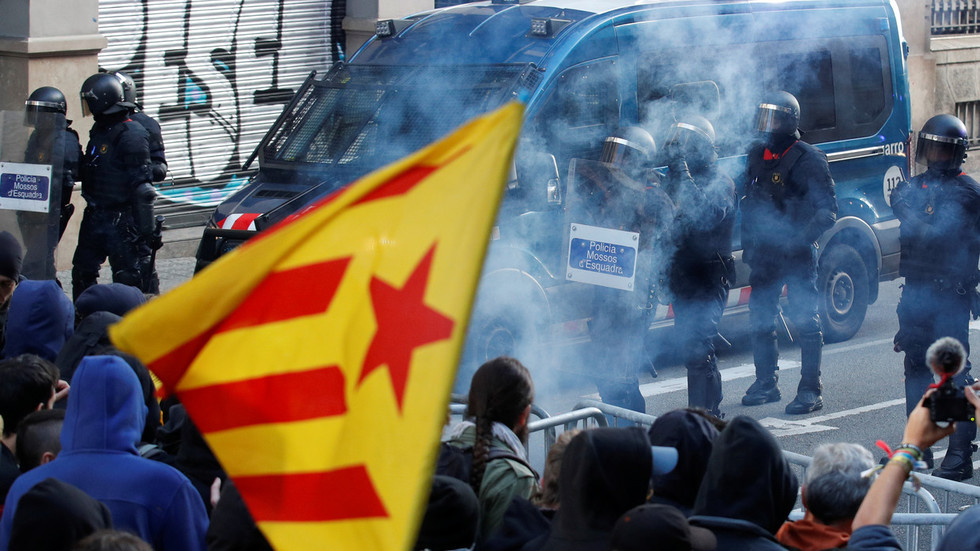 Catalan pro-independence activists scuffle with police at massive rally in Barcelona