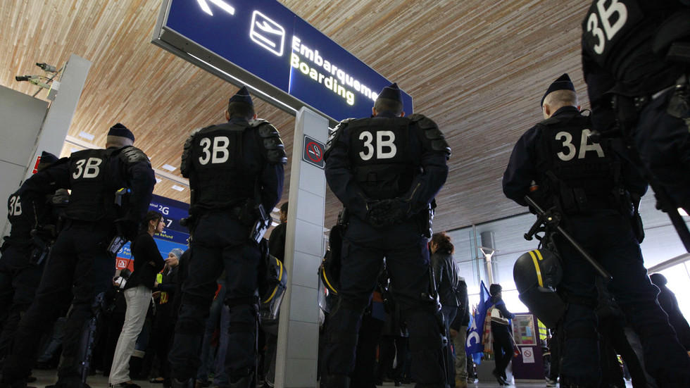 Panic & evacuation at Paris CDG airport as pair armed with fake guns sneak into terminal