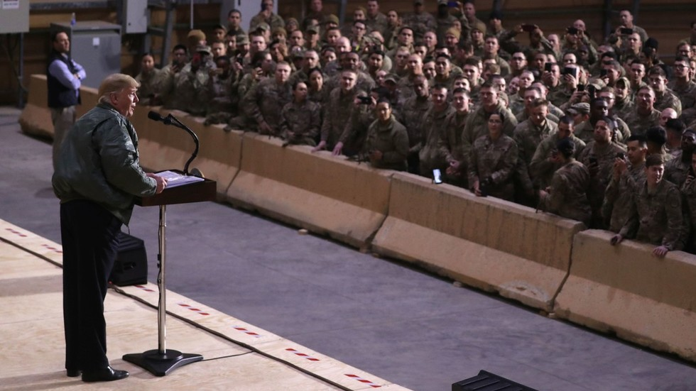 No pull out of Iraq, it can be base 'to do something in Syria' - Trump on first visit to troops