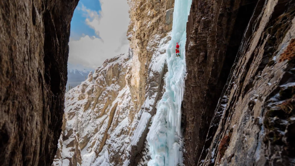 Extreme 'Santa' climbs frozen falls in epic end to Christmas 2018