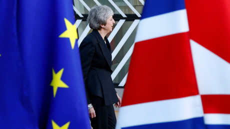 British MPs to vote on May's Brexit deal in January