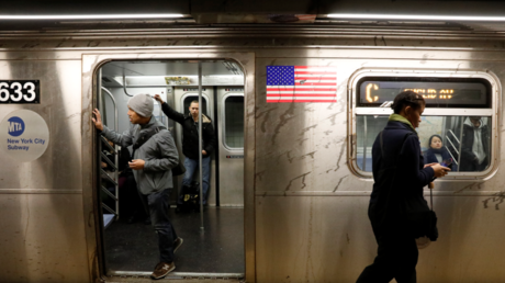 Woman's bizarre, racially charged, NY subway fight sparks citizen's arrest (VIDEOS, PHOTOS)