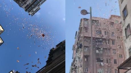 'Superhero of justice' or PR stunt? Cash rained down on poor Hong Kong neighborhood (VIDEOS)