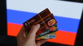 Major Russian bank ready to shut off Visa & Mastercard, halves dollar holdings